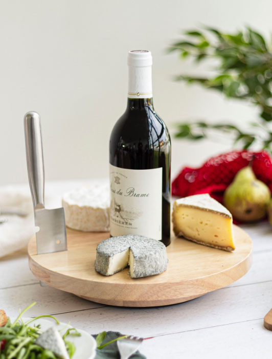 Photographie d'une planche à fromage Livoo avec ingrédients